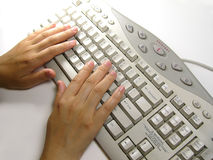 Hand on keyboard. Hand and keyboard royalty free stock photography