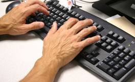 Hand on keyboard. A businessman types on keyboard Royalty Free Stock Photo
