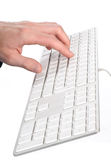 Hand on the keyboard computer Stock Photo