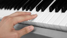 Hand and keyboard instrument Stock Images