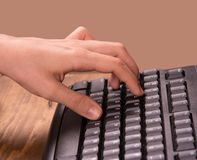 Hand on keyboard keys Royalty Free Stock Photography