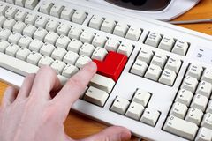 Hand and Keyboard with red button Royalty Free Stock Photography