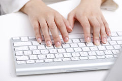 Hand on keybroad. A woman's hand on white keybroad typewriting Stock Images