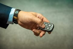 Hand with keychain with security button royalty free stock photo