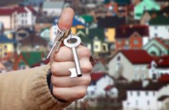 Hand and keys. Real Estate agent hands over the keys Stock Photos