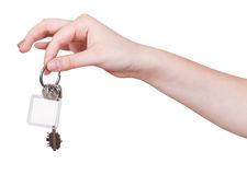 Hand with keys and blank key fob isolated Royalty Free Stock Photography