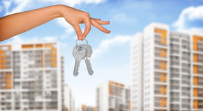 Hand with keys and buildings Royalty Free Stock Photos