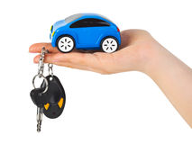 Hand with keys and car. Isolated on white background Stock Photos