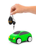 Hand with keys and car Royalty Free Stock Image