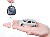 Hand with keys and car Stock Images