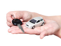 Hand with keys and car Royalty Free Stock Images