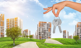 Hand with keys and city Stock Image