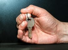 Hand with keys. On a dark background Royalty Free Stock Image