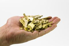 Hand and keys III royalty free stock photography