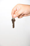 Hand and keys. Key and hand isolated on white background Royalty Free Stock Photos