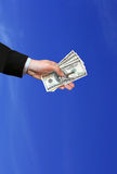 Hand, keys and money. Hand with keys and money on blue background Royalty Free Stock Photos