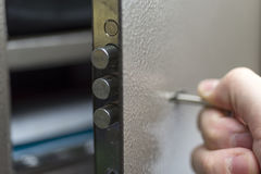 The hand with the keys opens the safe Deposit box. The hand with the keys opens the safe Deposit box protected Stock Image