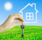 Hand with the keys to the future home Stock Images