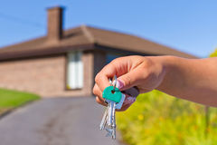 Hand with keys to new house. Female hand holding keys to new dream house Royalty Free Stock Photography