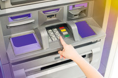 Hand of kid using ATM Royalty Free Stock Photos