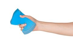 Hand with kitchen sponge. Woman hand with kitchen sponge for ware washing isolated on white background royalty free stock photos
