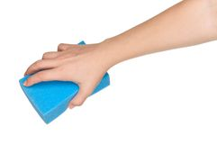 Hand with kitchen sponge. Woman hand with kitchen sponge for ware washing isolated on white background royalty free stock photo
