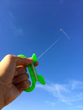 Hand with kite against sky Royalty Free Stock Photography