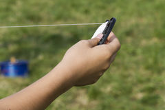 Hand and kite Stock Photography