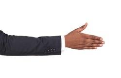 Hand klaar voor handdruk op wit wordt geïsoleerd dat Stock Foto