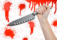 Hand with knife. On the background bloody splatters royalty free stock photos