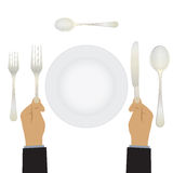 Hand with a knife and fork. Tableware. Stock Photography