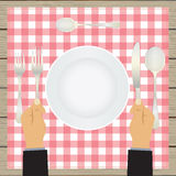 Hand with a knife and fork. Tableware. Stock Images