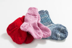 Hand-knitted baby socks Stock Photos