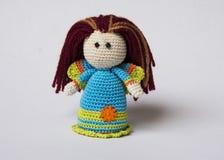 Hand knitted Crochet Angel. A colourful hand knitted crochet angel with streaked hair using crochet thread Stock Photos