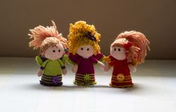 Hand knitted Crochet dolls of three angels. Three colourful hand knitted crochet angels with straight and curly hair using crochet thread Royalty Free Stock Image