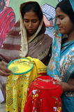Hand knitted garments. Two Indian women are making embroidery designs on garments in a craft fair Royalty Free Stock Photo