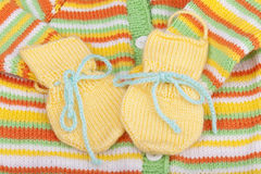 Hand-knitted woolen baby gloves. Royalty Free Stock Images