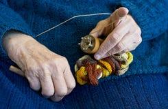 Senior woman knitting. stock images