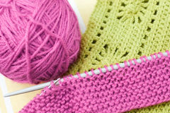 Hand knitwork. Knitting needls, yarn ball and pieces of knitted and crochetted works Royalty Free Stock Photography