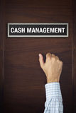 Hand is knocking on Cash Management door Royalty Free Stock Image