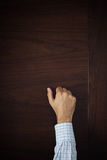 Hand is knocking on the door Royalty Free Stock Image