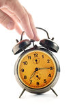 Hand knocking down vintage clock Stock Photo