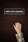 Hand is knocking on Employee Banking door Royalty Free Stock Photo