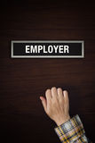 Hand is knocking on Employer door Royalty Free Stock Photography