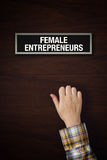 Hand is knocking on Female Entrepreneurs door Stock Photography