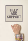 Hand is knocking on help And Support door Royalty Free Stock Image