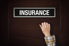 Hand is knocking on Insurance door Stock Images