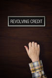 Hand is knocking on Revolving Credit door Royalty Free Stock Photos