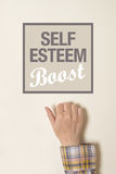 Hand is knocking on Self-esteem boost door. Female hand is knocking on Self-esteem boost door, conceptual image stock photos
