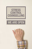Hand is knocking on Stress Cotrol Counselling door. Female Hand is knocking on Stress Cotrol Counselling door, conceptual image Stock Photo
